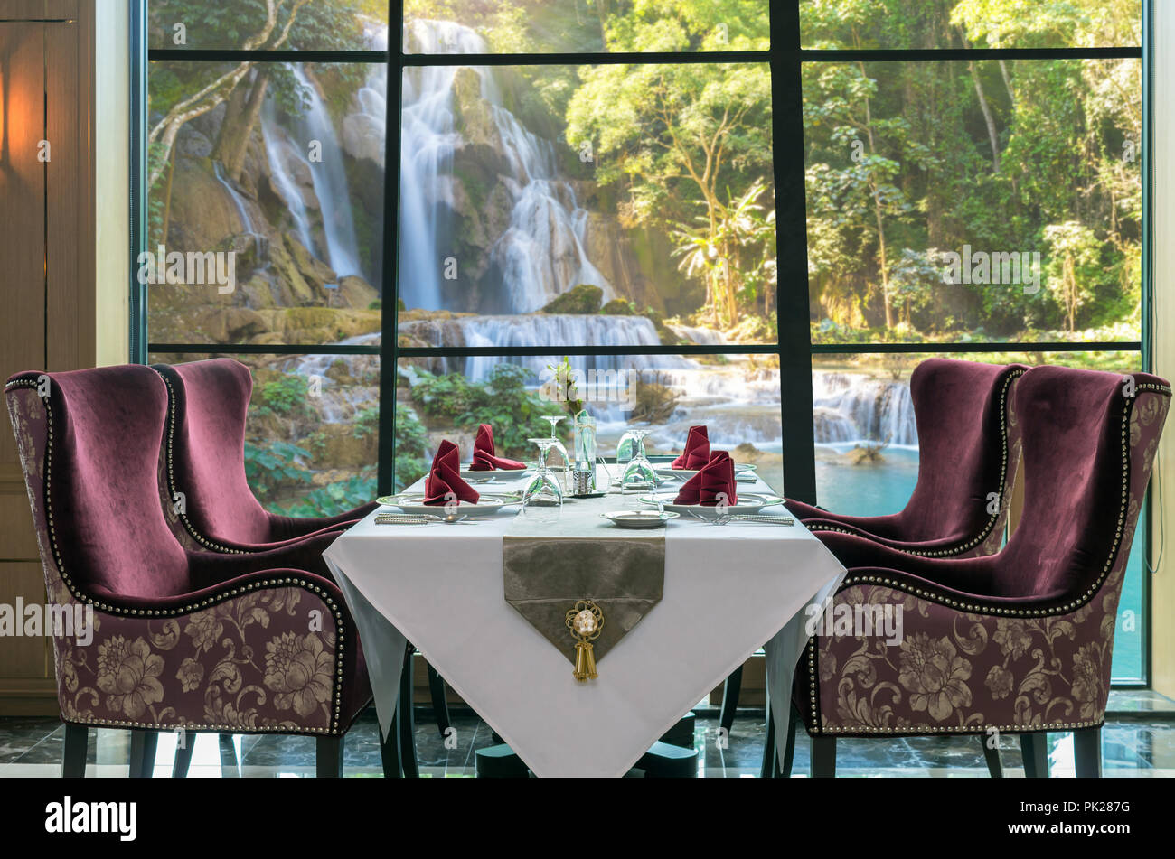 Luxury restaurant set over windows glass of the view of Beautiful waterfall in the forest, dicut each elements Stock Photo