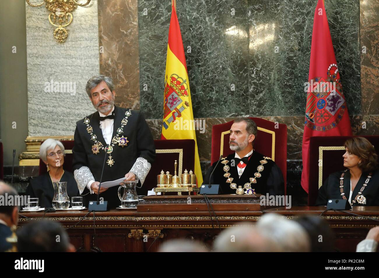 Spain's King Felipe VI (2R) next to Spanish Justice Minister