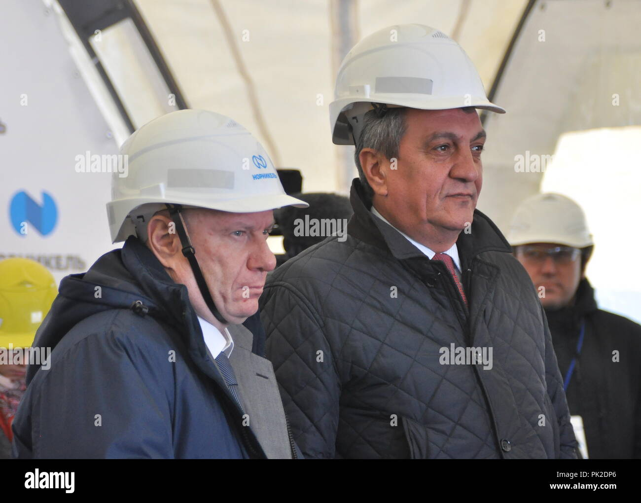 Norilsk, Russia. 10th Sep, 2018. NORILSK, RUSSIA - SEPTEMBER 10, 2018: MMC Norilsk Nickel President and Board Chairman Vladimir Potanin (L) and Sergei Menyailo, Presidential Envoy to Russia's Siberian Federal District, launch a project aimed at reducing sulfur dioxide emissions, at a copper plant of MMC Norilsk Nickel. Denis Kozhevnikov/TASS Credit: ITAR-TASS News Agency/Alamy Live News - Stock Image