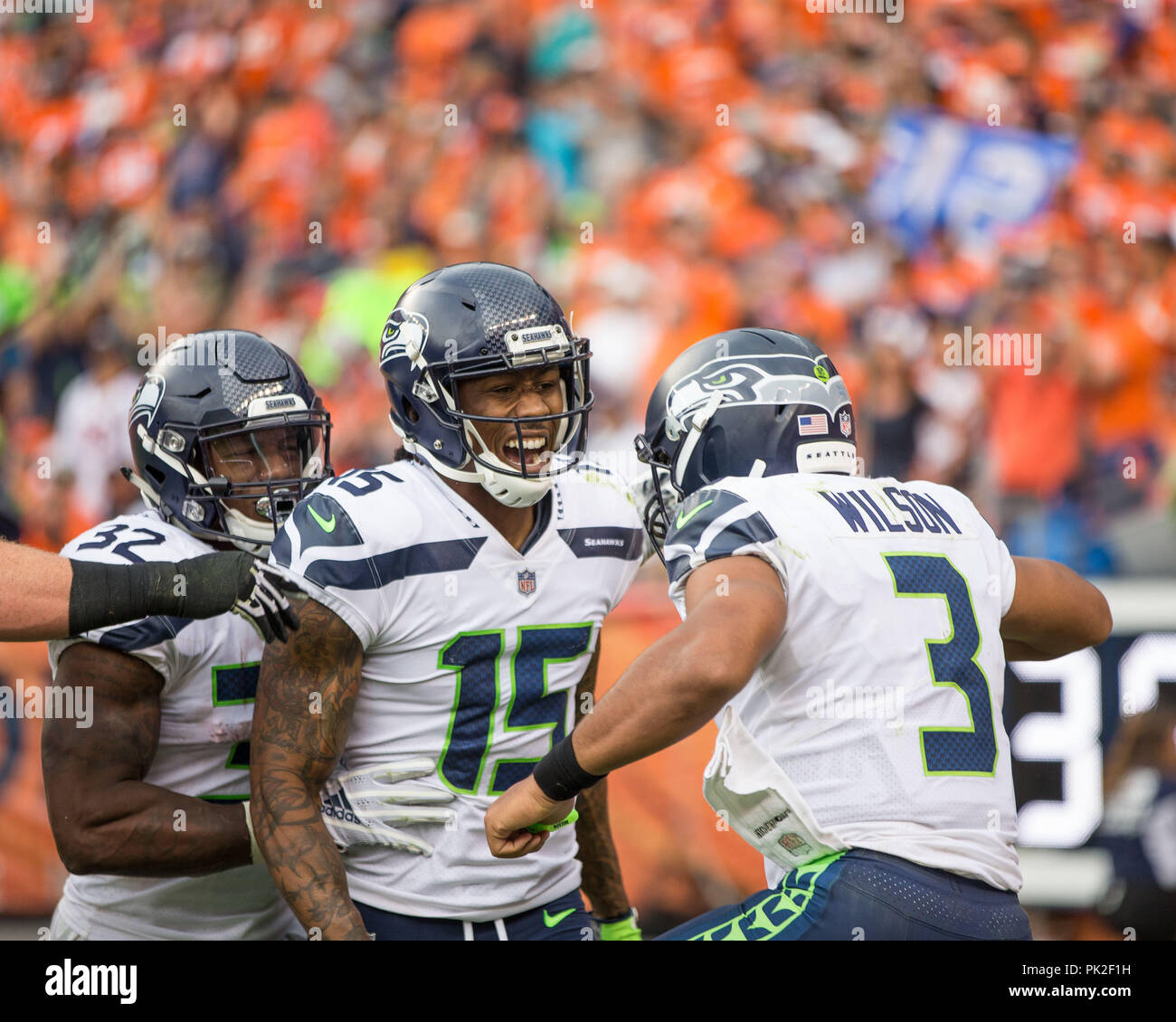 9f1edc22 September 09, 2018: Seattle Seahawks wide receiver Brandon Marshall (15)  celebrates with Seattle Seahawks quarterback Russell Wilson (3) after  scoring a ...