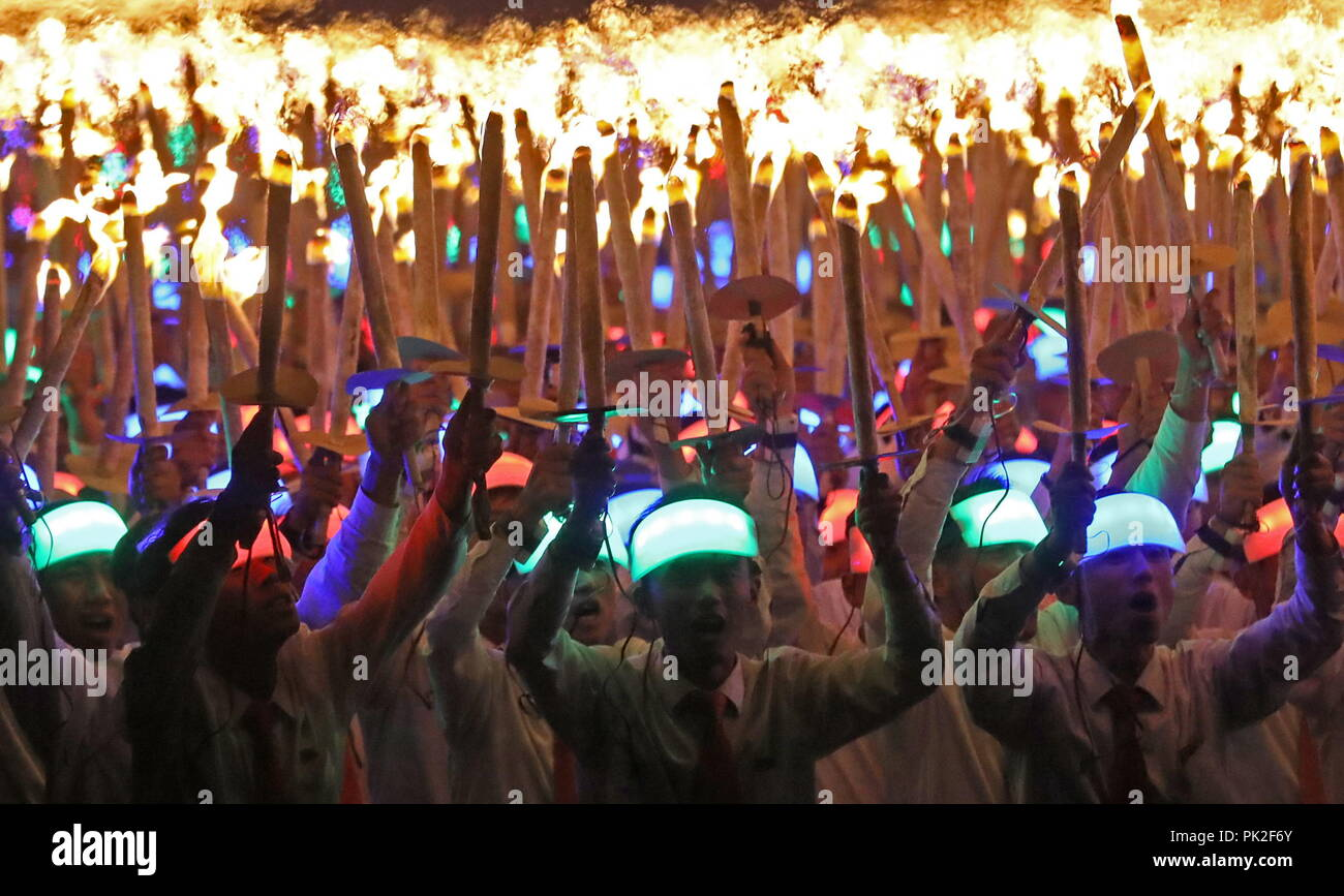Pyongyang, North Korea. 10th Sep, 2018. PYONGYANG, NORTH KOREA - SEPTEMBER 10, 2018: Young people stage a torchlight parade in Pyongyang's Kim Il-sung Square to celebrate the 70th anniversary of the Korean Democratic People's Republic (North Korea). Alexander Demianchuk/TASS Credit: ITAR-TASS News Agency/Alamy Live News - Stock Image