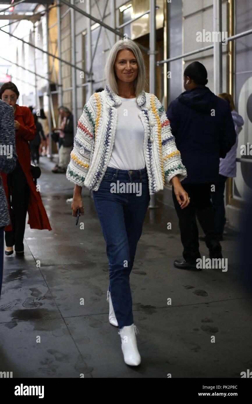 Sarah Harris, Deputy Editor Vogue UK, posing on the street outside
