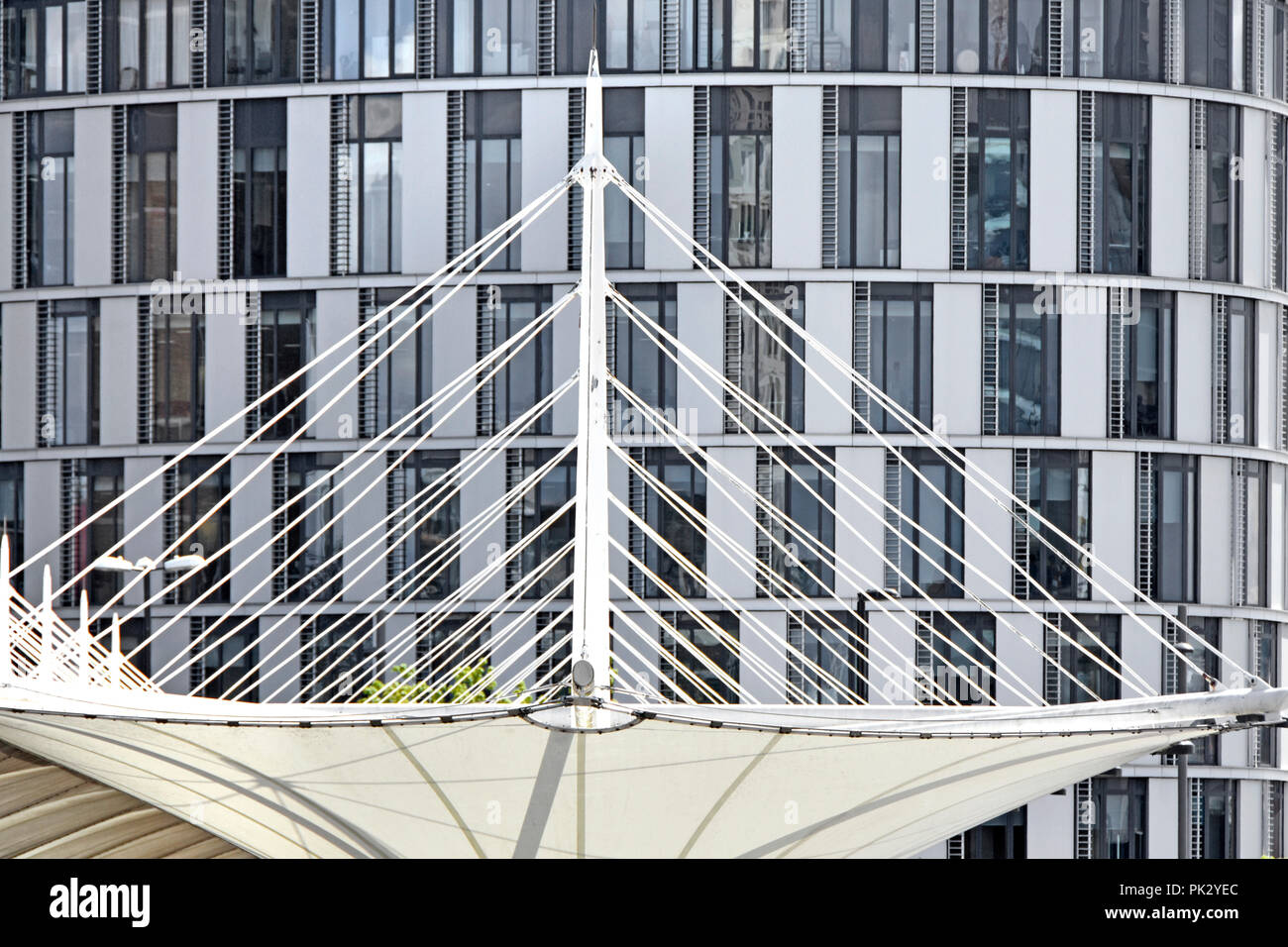 Conflicting shapes of rectangles & white triangles in two modern building structure design views in nearly greyscale abstract architecture pattern UK - Stock Image