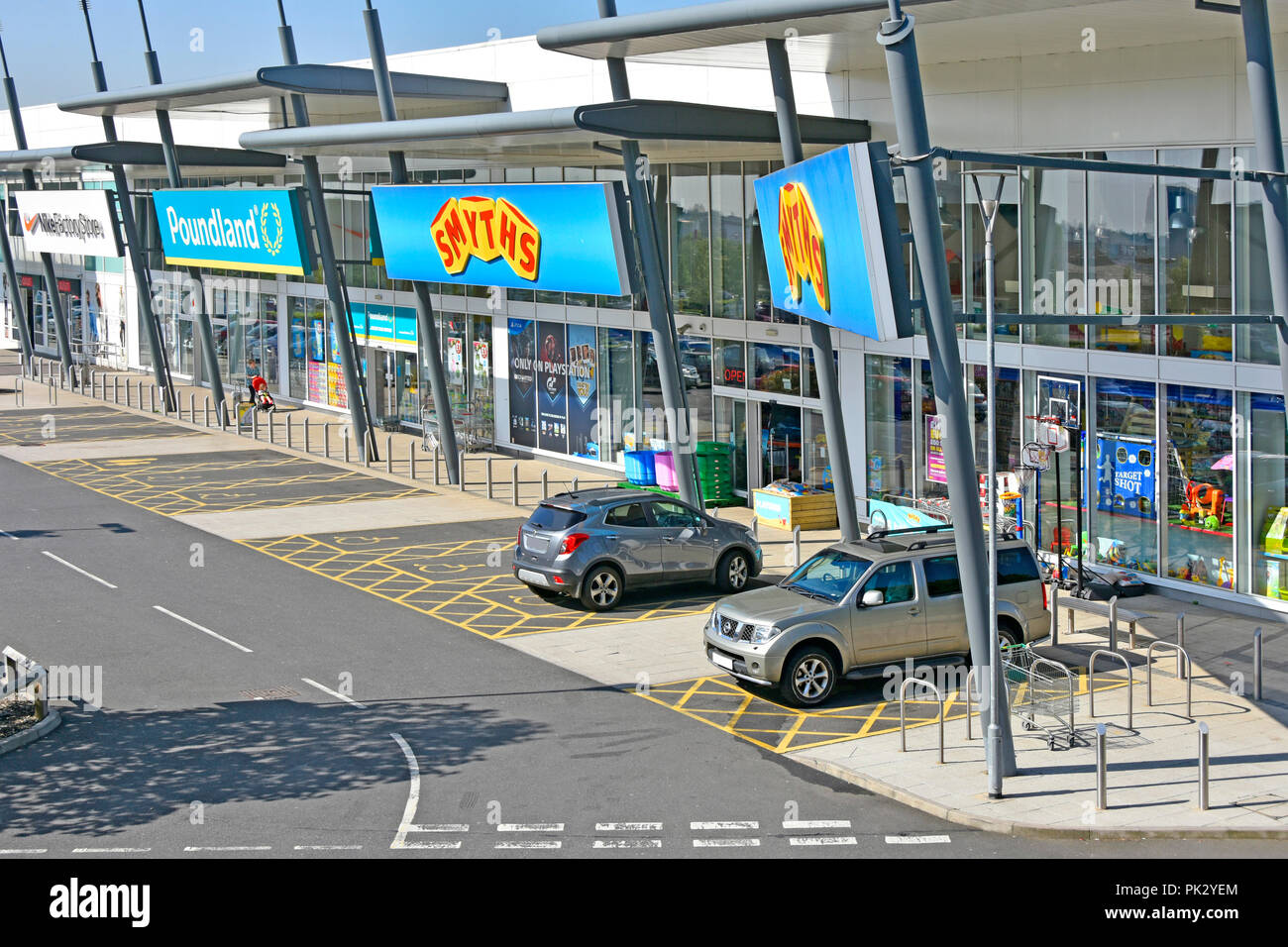 Looking down on Smyths Toys & Poundland shopping stores & wheelchair user disability parking bay space Lakeside retail park Thurrock Essex England UK - Stock Image