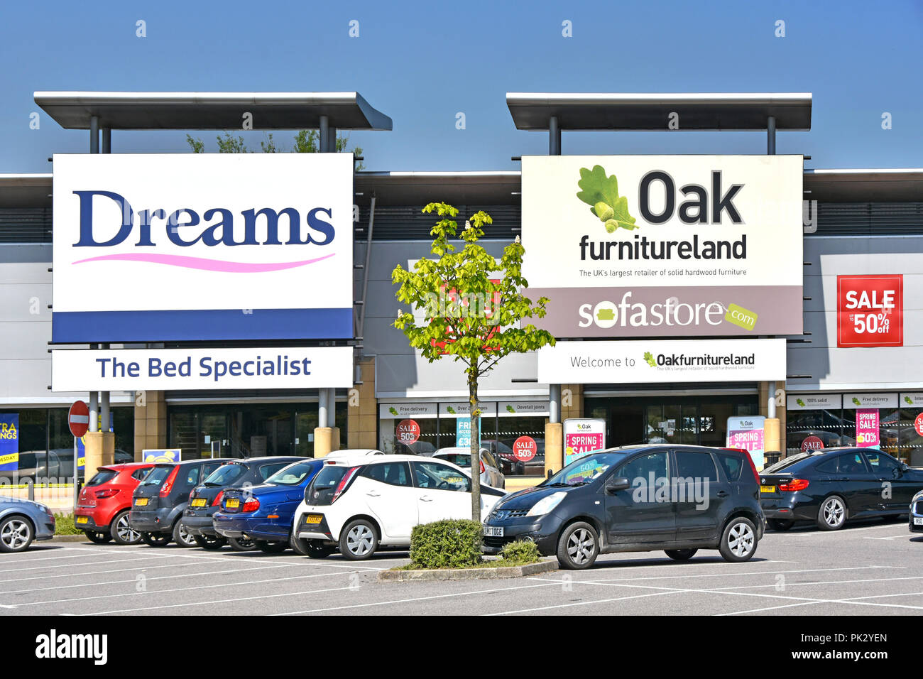 Dreams bed & Oak furniture sofa store sign for home furniture shopping free car park for shoppers at Lakeside retail park Thurrock Essex England UK - Stock Image