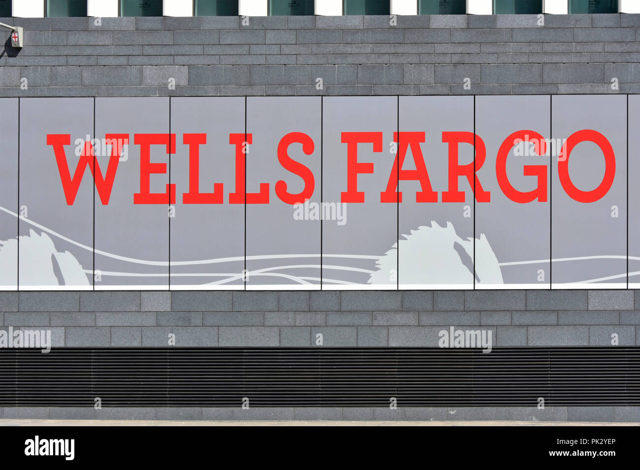 Close up red sign at base of new Wells Fargo Bank