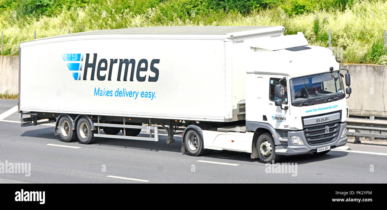 Transportation by Hermes Makes delivery easy says advertising slogan on side of supply chain transport hgv lorry truck M25 motorway Essex England UK - Stock Image