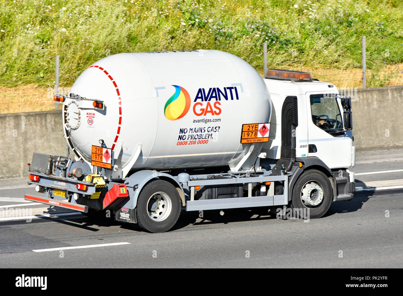 Short wheelbase Avanti Gas LPG logo supply chain tanker lorry truck transport warning sign flammable & advert for property without main gas England UK - Stock Image