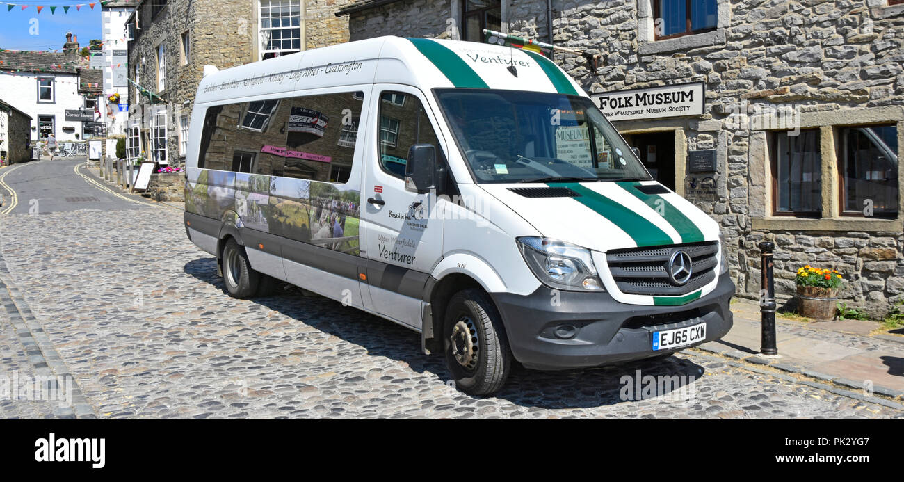 Bus stop outside Grassington Folk Museum building with Venturer community minibus service for villages in Upper Wharfedale North Yorkshire England UK Stock Photo