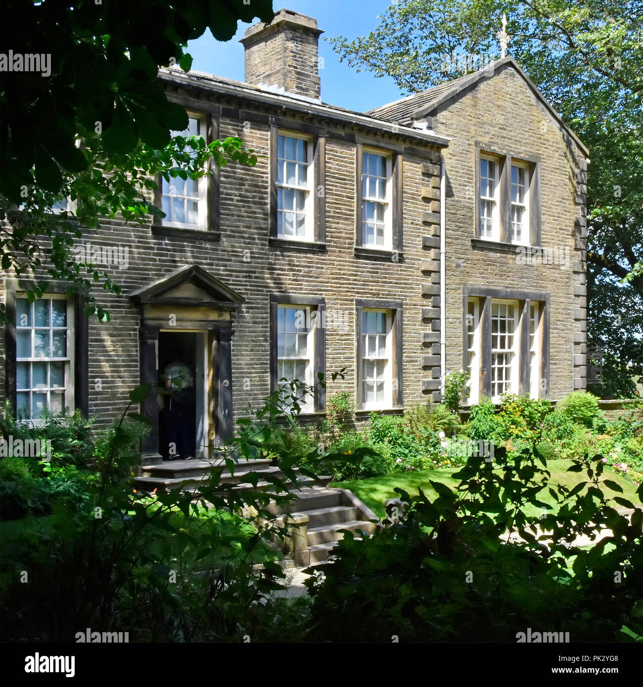 Bronte sisters family home & garden now the Brontes Parsonage Museum supporting a major tourism attraction to the Haworth village & West Yorkshire UK - Stock Image