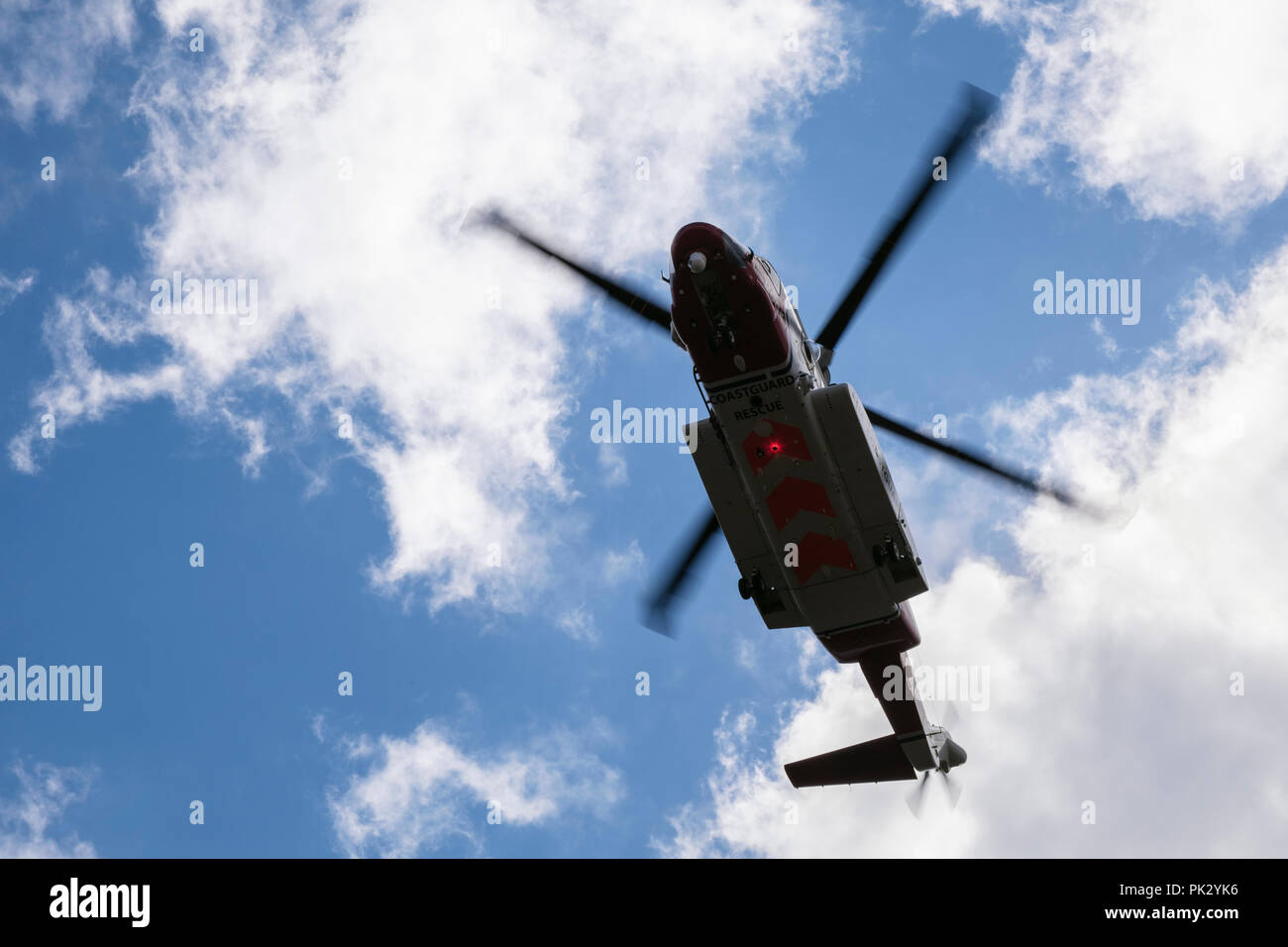 HM Coastguard Bristow search and rescue 936 helicopter hovering overhead during a mountain rescue operation in Snowdonia, Wales, UK, Britain - Stock Image