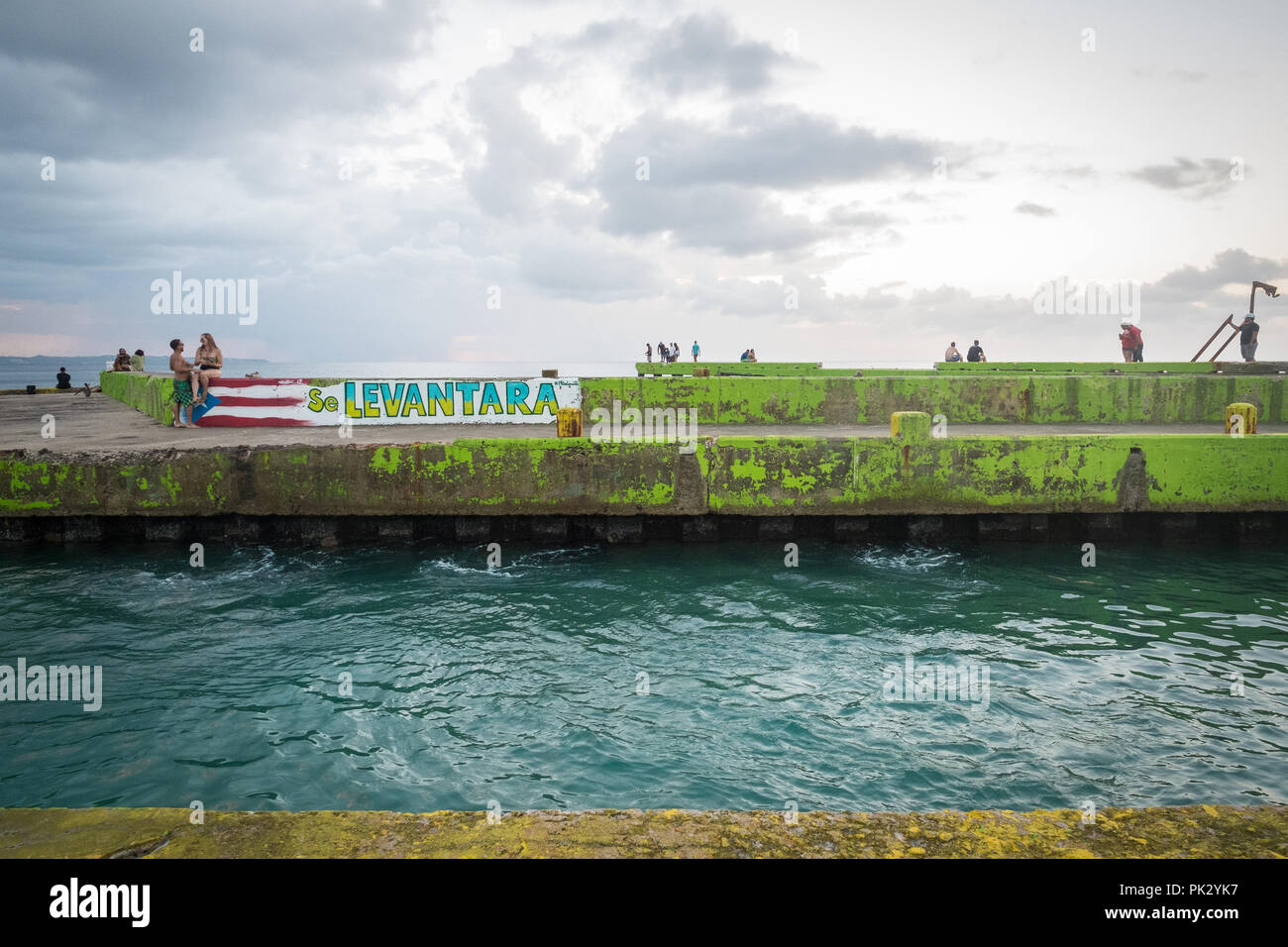 Aguadilla, Puerto Rico. 22, October, 2017. Graffiti on the broken pier of Crash Boat Beach expresses the hopes and determination of residents of Puerto Rico to survive and rebuild their island better than it was before Hurricane Maria destroyed much of its infrastructure in September 2017. Credit: Sara Armas/Alamy Reportage. - Stock Image