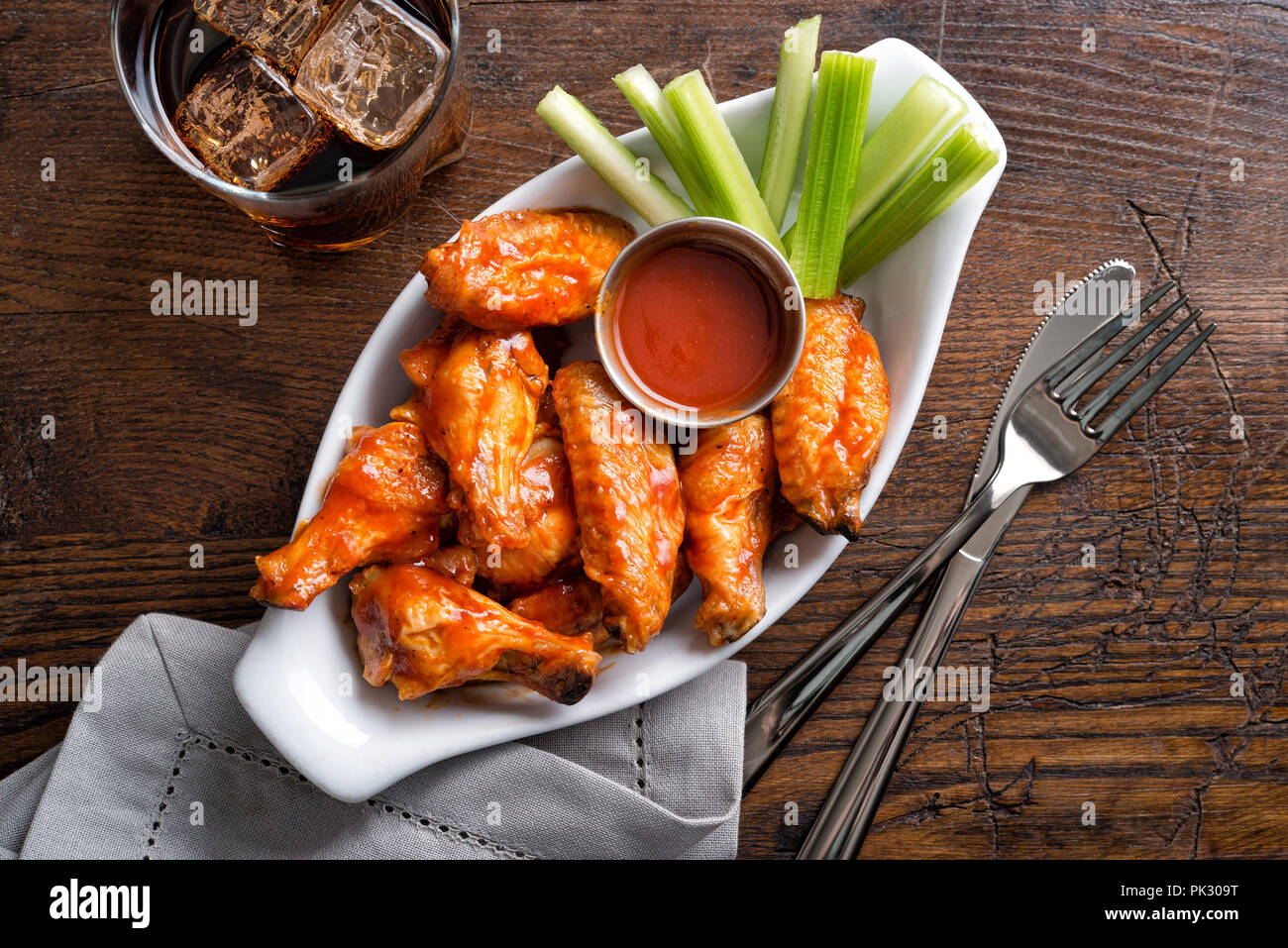 A Serving Of Delicious Spicy Buffalo Chicken Wings On A Pub
