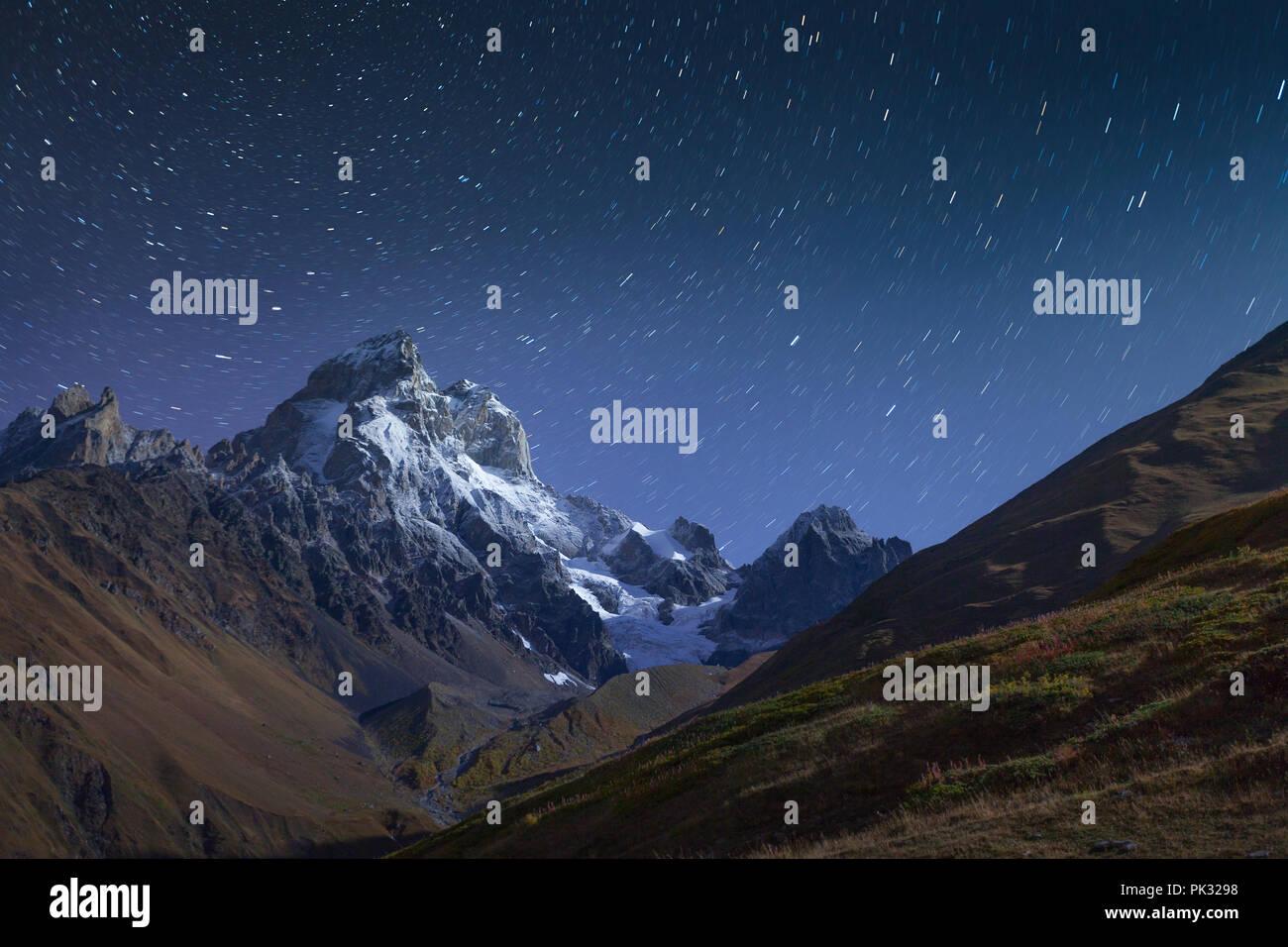 Night view of Mt. Ushba in Caucasus mountains. Upper Svaneti, Main Caucasus ridge, Georgia, Europe. October 2015. - Stock Image