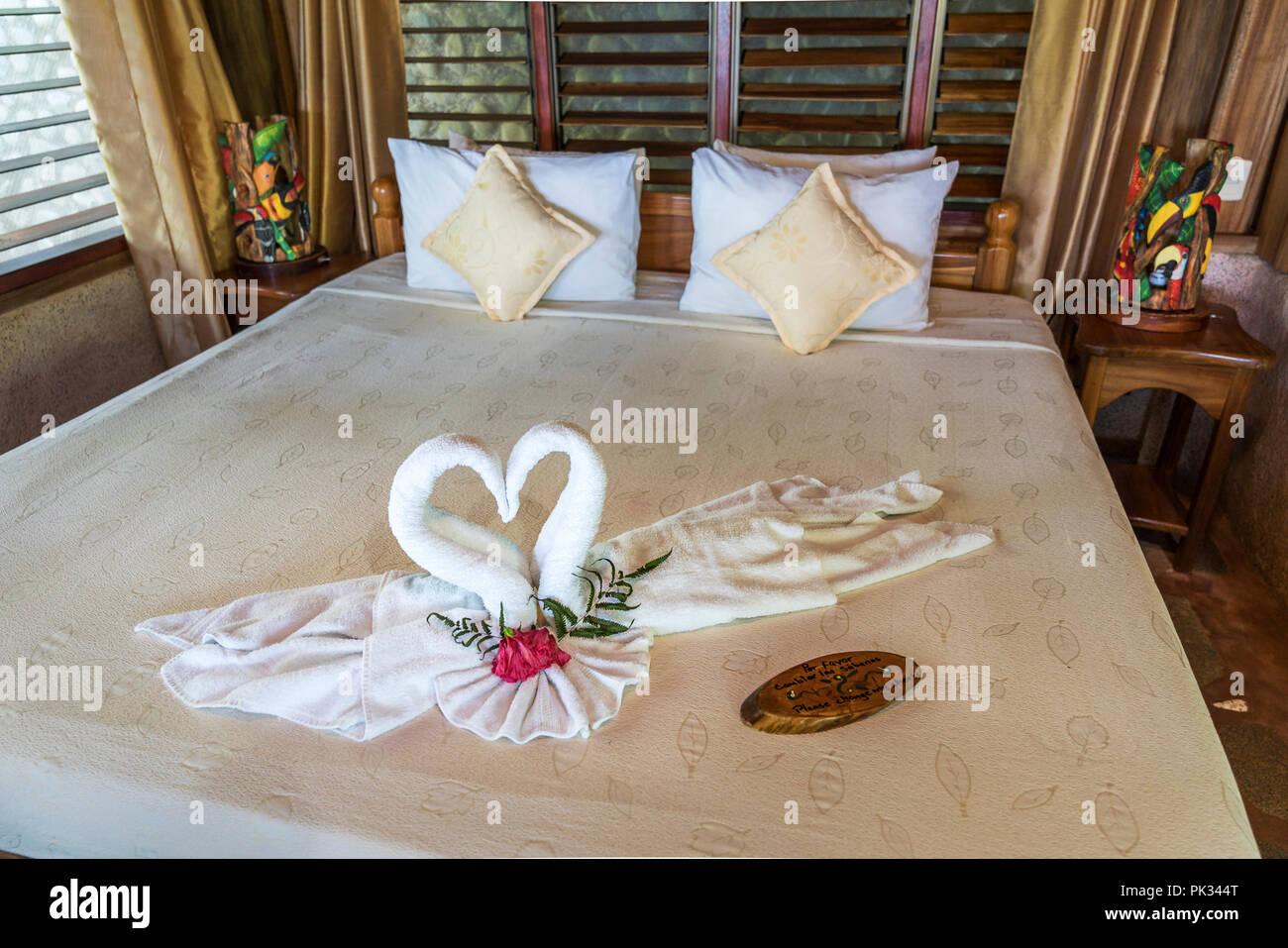 Towel displayed as Swans, LaCusinga Hotel, Costa Rica - Stock Image