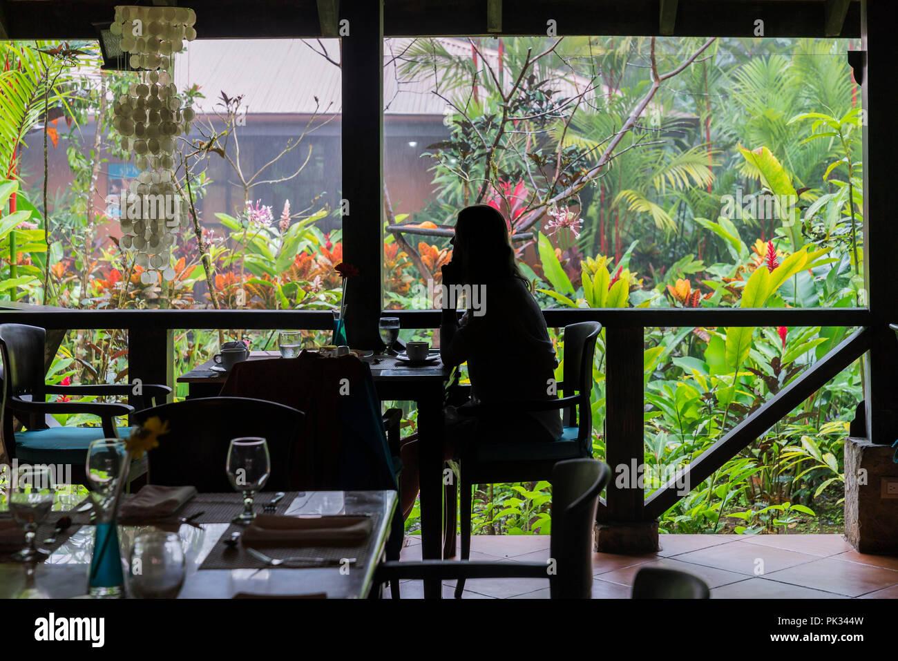 Silhouette of Woman at the Mirador El Silencio hotel, San Carlos, Costa Rica - Stock Image