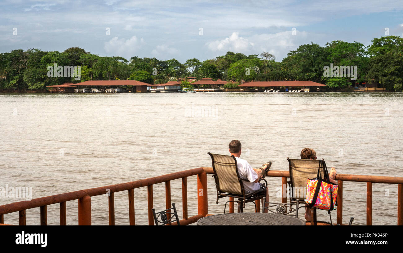 Couple on the deck at Pachira Lodge, Costa Rica - Stock Image