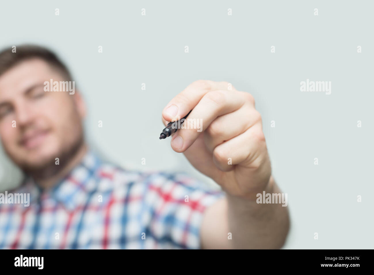 Template - businessman draws or write a with marker on the glass wall or screen - Stock Image