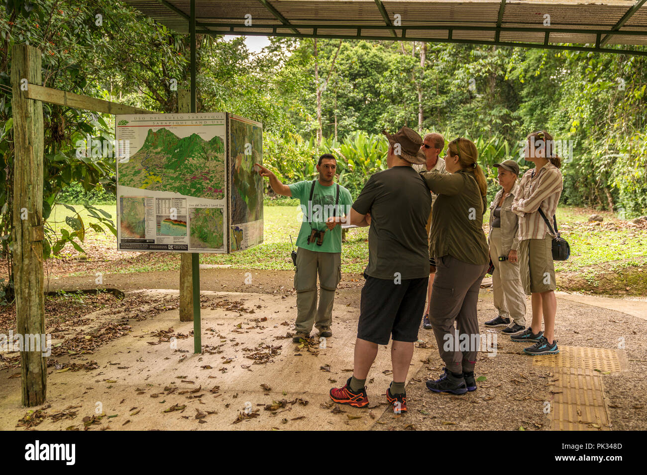 Tour guide with a Tourists, Tenorio Volcano National Park, Costa Rica - Stock Image