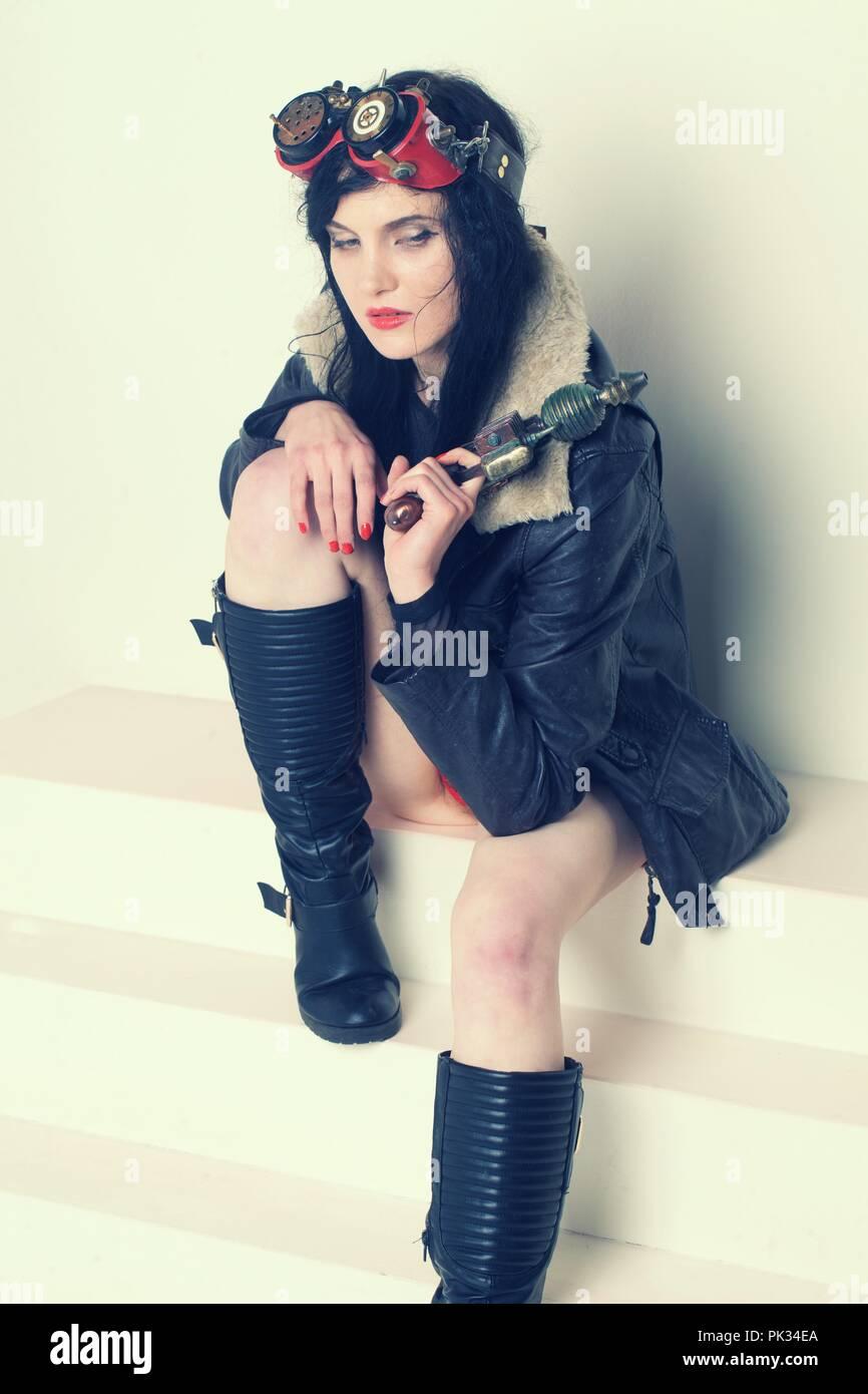 Sci fi dieselpunk or steampunk girl with ray gun - Stock Image