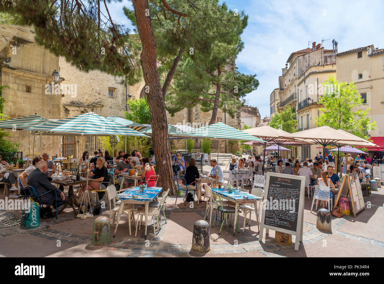 Cafes and restaurants on Rue Saint-Paul in the historic old town, Montpellier, Languedoc, France Stock Photo