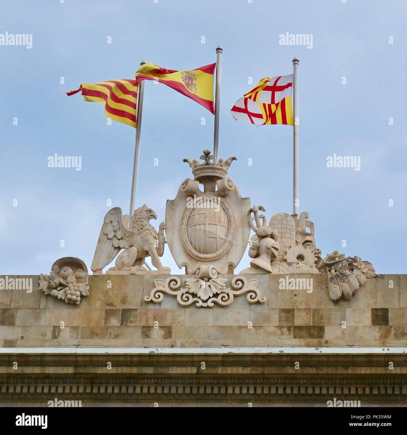 Flags flying for Barcelona, Catalonia and Spain. City Hall, Place de Sant Joame, Barcelona. Hot summer afternoon August 2018. - Stock Image
