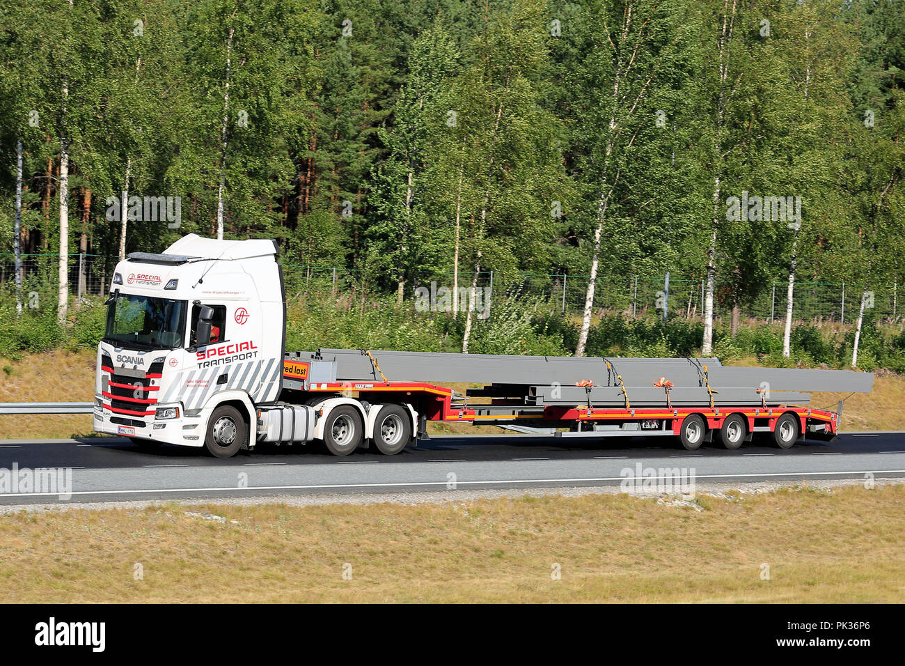 Next Generation Scania R500 of Ismo Partanen for AT Special Transport hauls long oversize load on motorway. Salo, Finland - August 3, 2018. - Stock Image