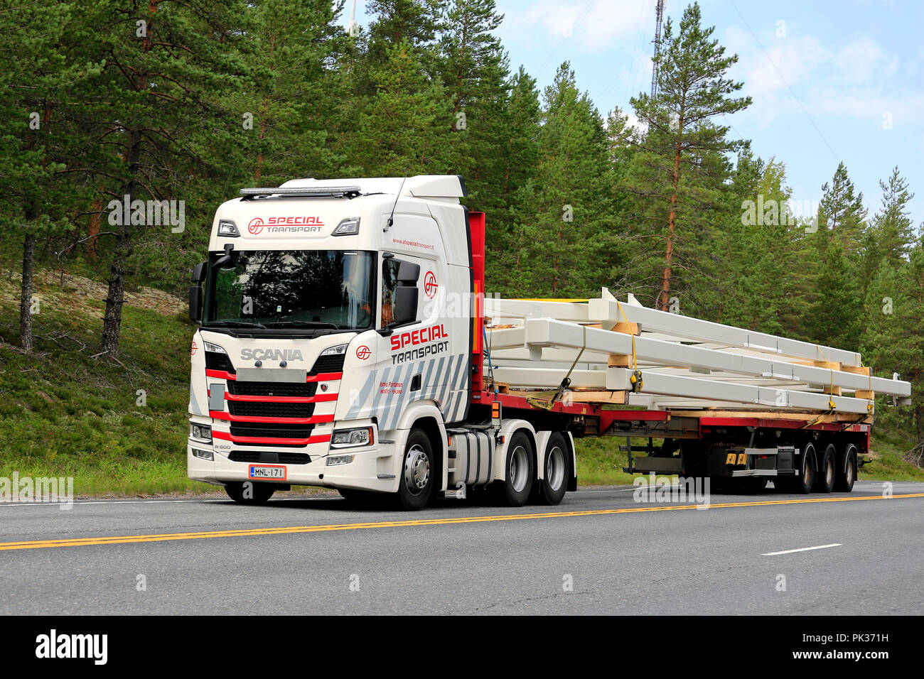 Next Generation Scania R500 of Ismo Partanen for AT Special Transport hauls oversize industrial object on road. Ikaalinen, Finland - August 9, 2018. - Stock Image