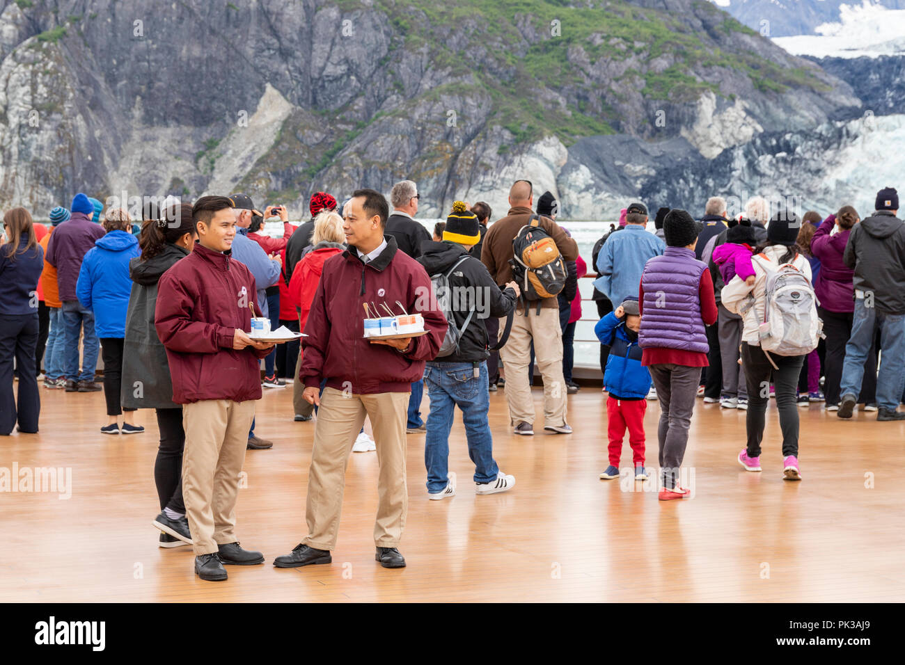 Stewards serving hot soup to passengers on board Holland America Line Cruises 'Nieuw Amsterdam' enjoying a close view of the Margerie Glacier in the T - Stock Image