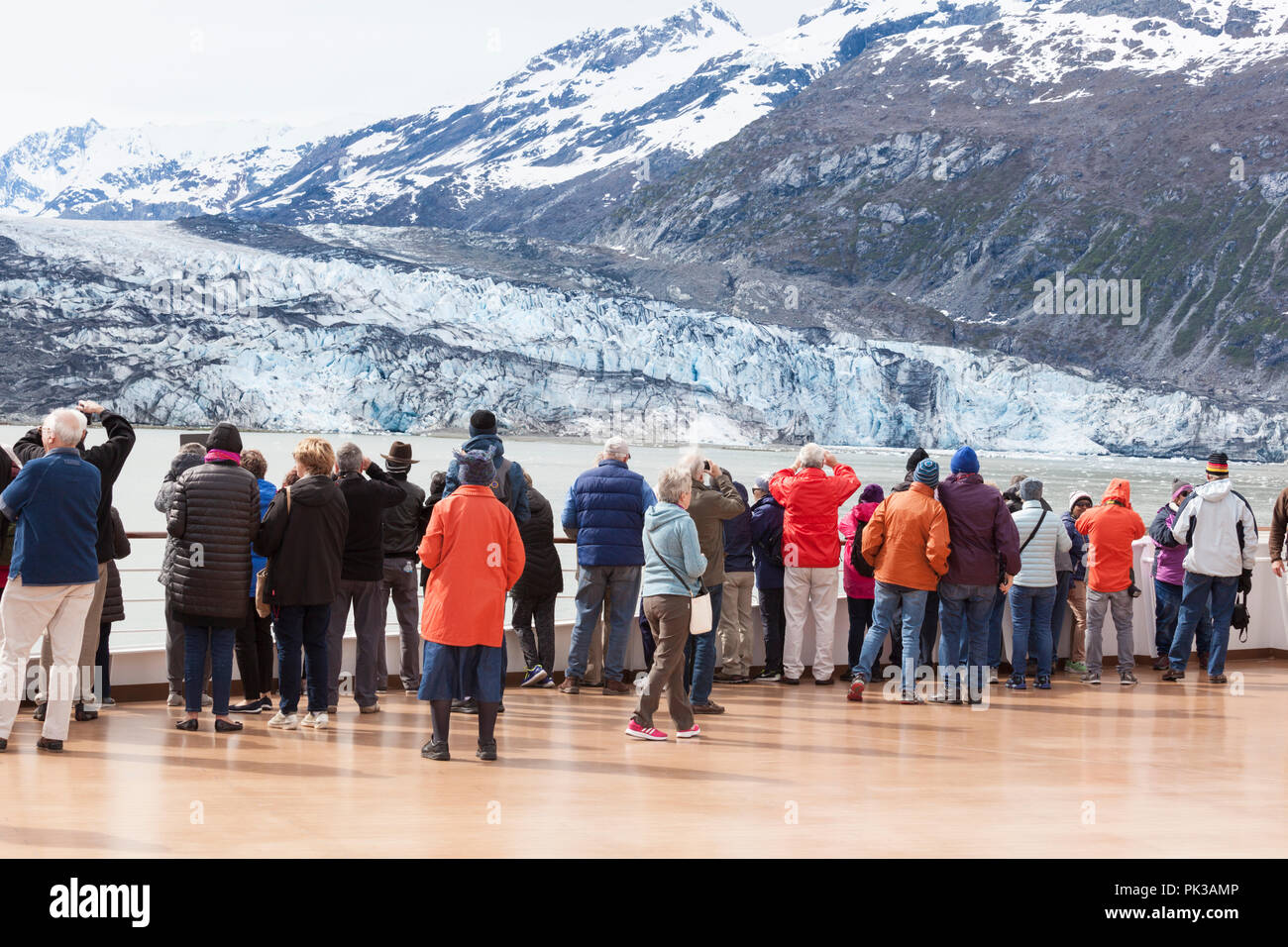 Passengers on the Holland America Line Cruises 'Nieuw Amsterdam' cruise ship enjoying the views of a glacier in Johns Hopkins Inlet of Glacier Bay - Stock Image