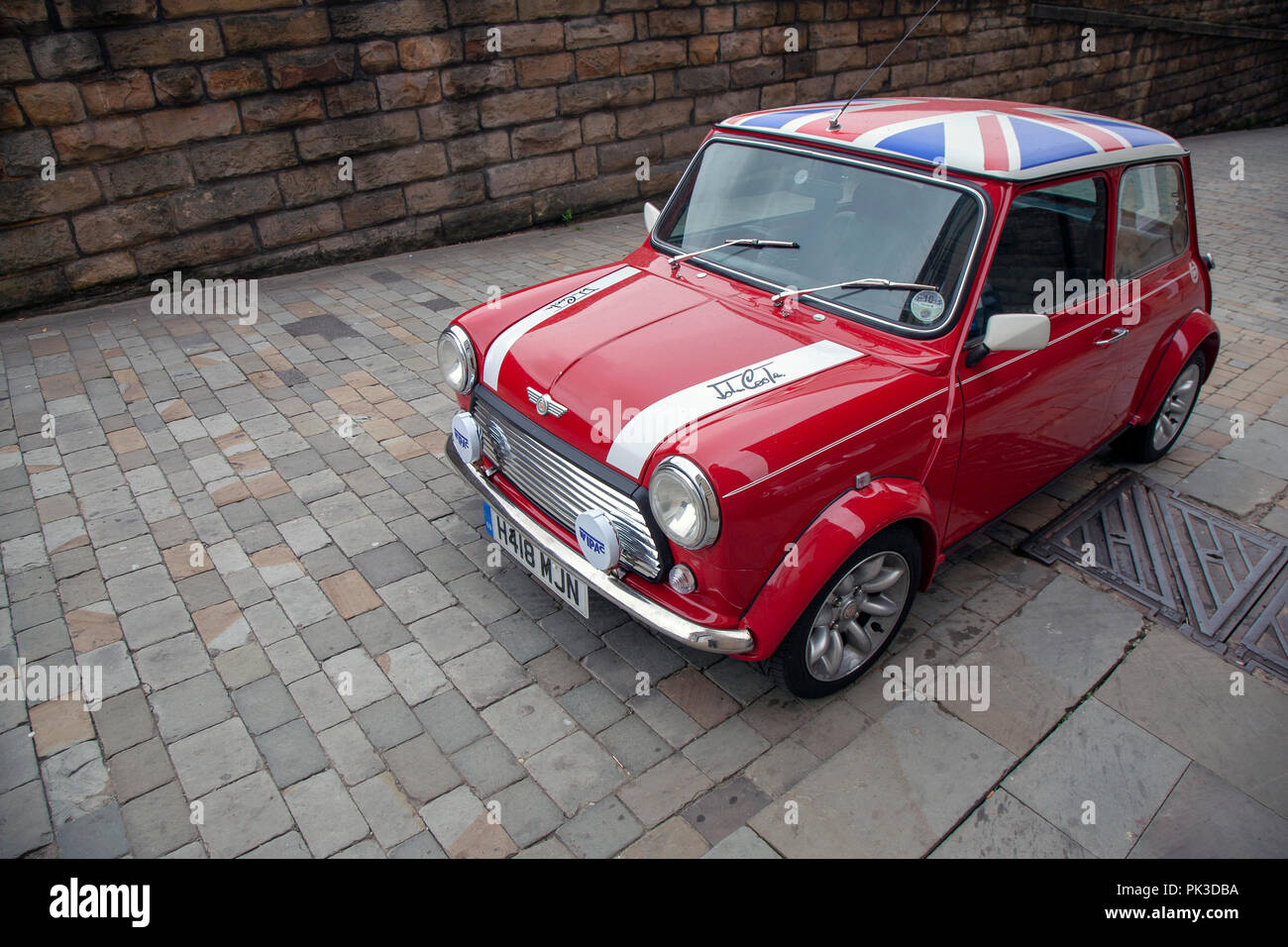A Red Mini Cooper Wth A Union Jack Roof By John Cooper Version Of