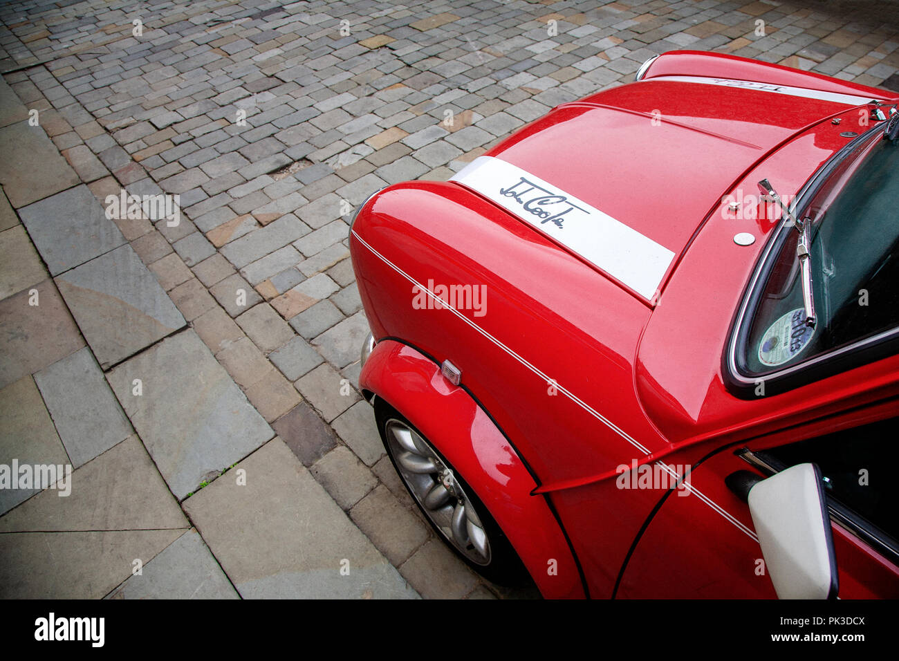 The John Cooper logo badge on the bonnet of a Red Mini Cooper, John Cooper version taken from high up looking down - Stock Image