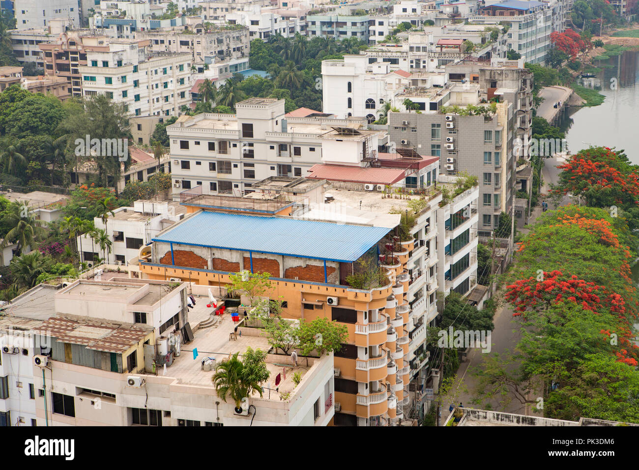 A view looking down on roof gardens and blocks of houses and flats in Dhaka, Bangladesh. - Stock Image