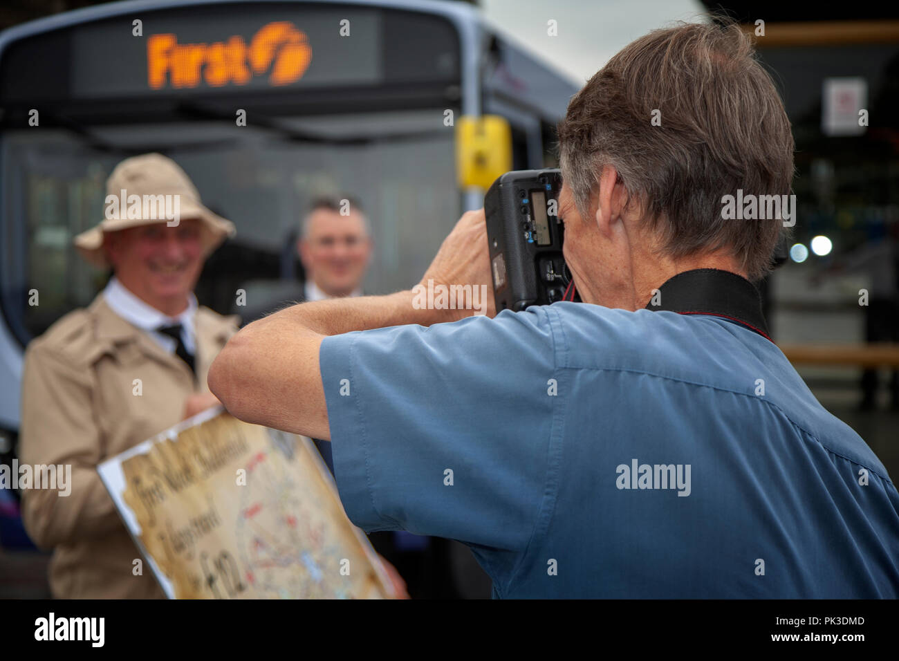 Professional Photographer taking pictures of a PR story in Huddersfield, West Yorkshire, England - Stock Image