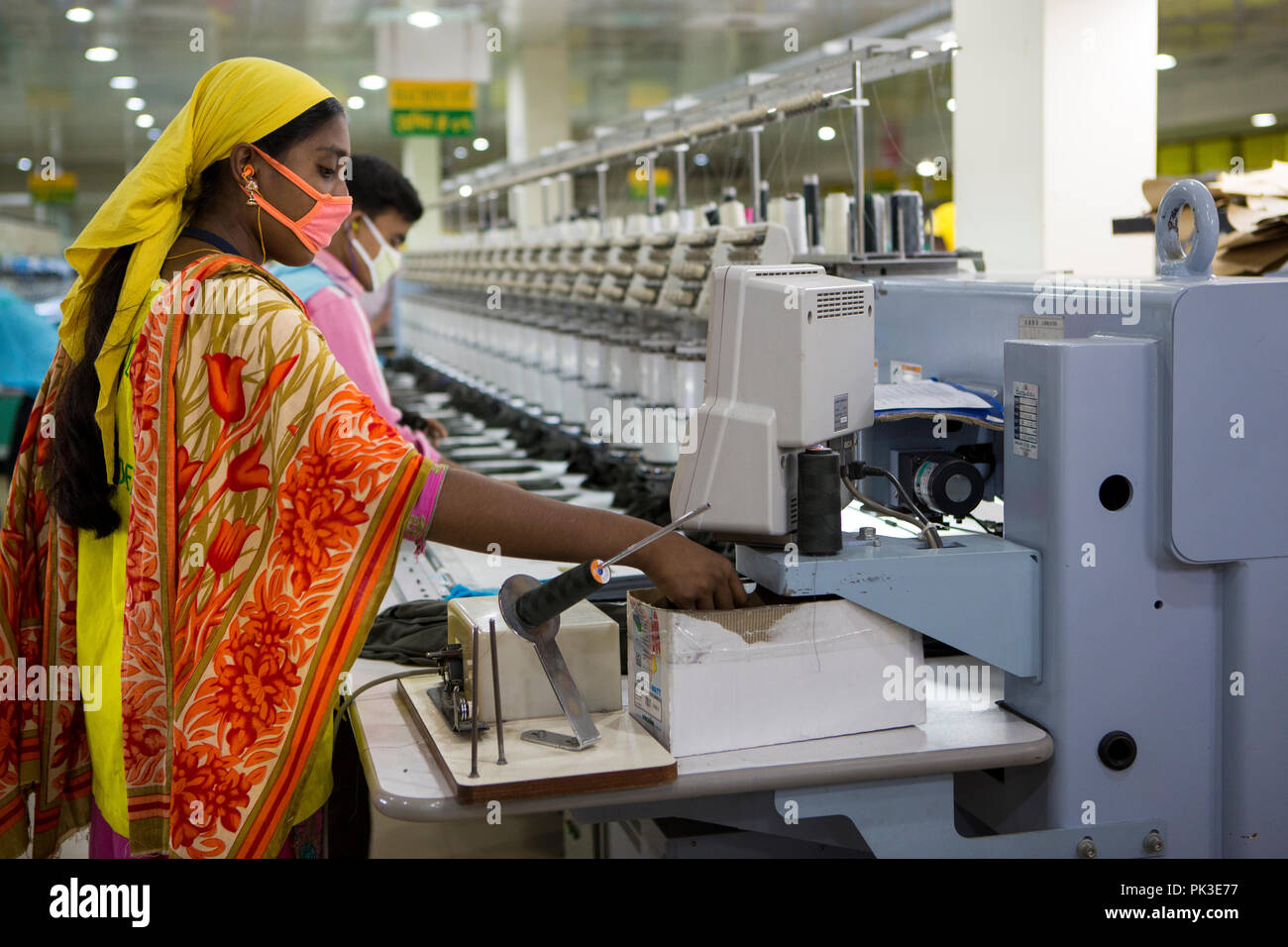 Garment workers at work on machines inside a garment factory