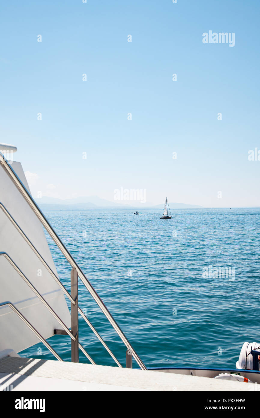 View of Lake Leman (Geneva Lake) on beautiful sunny summer day from open deck of modern boat - Stock Image