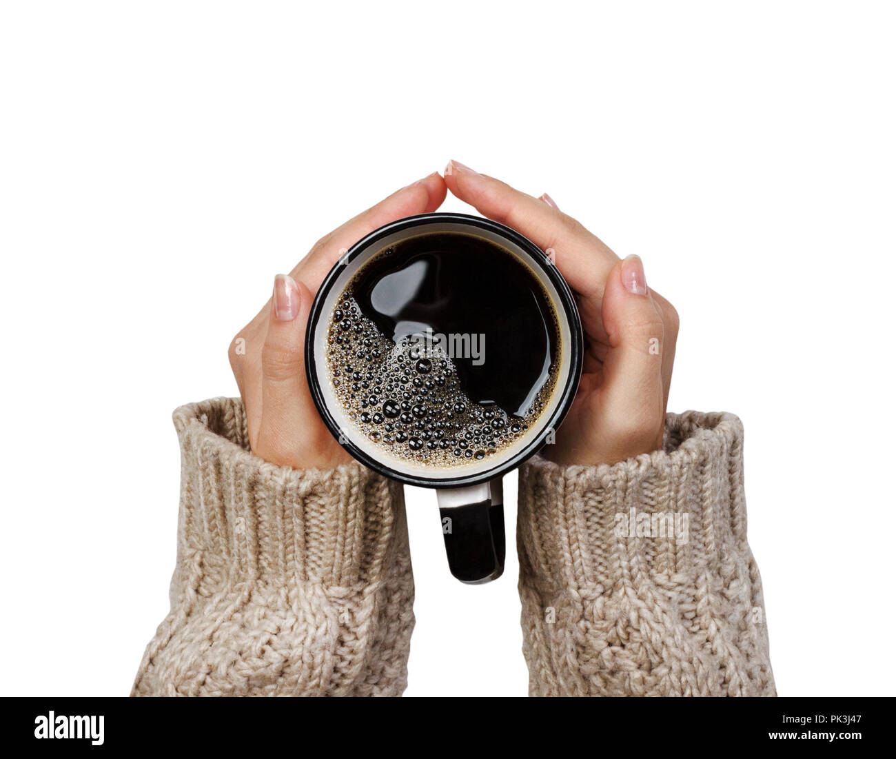 Woman holding cup of hot coffee isolated on white, closeup photo of hands in warm sweater with mug, winter morning concept, top view. - Stock Image