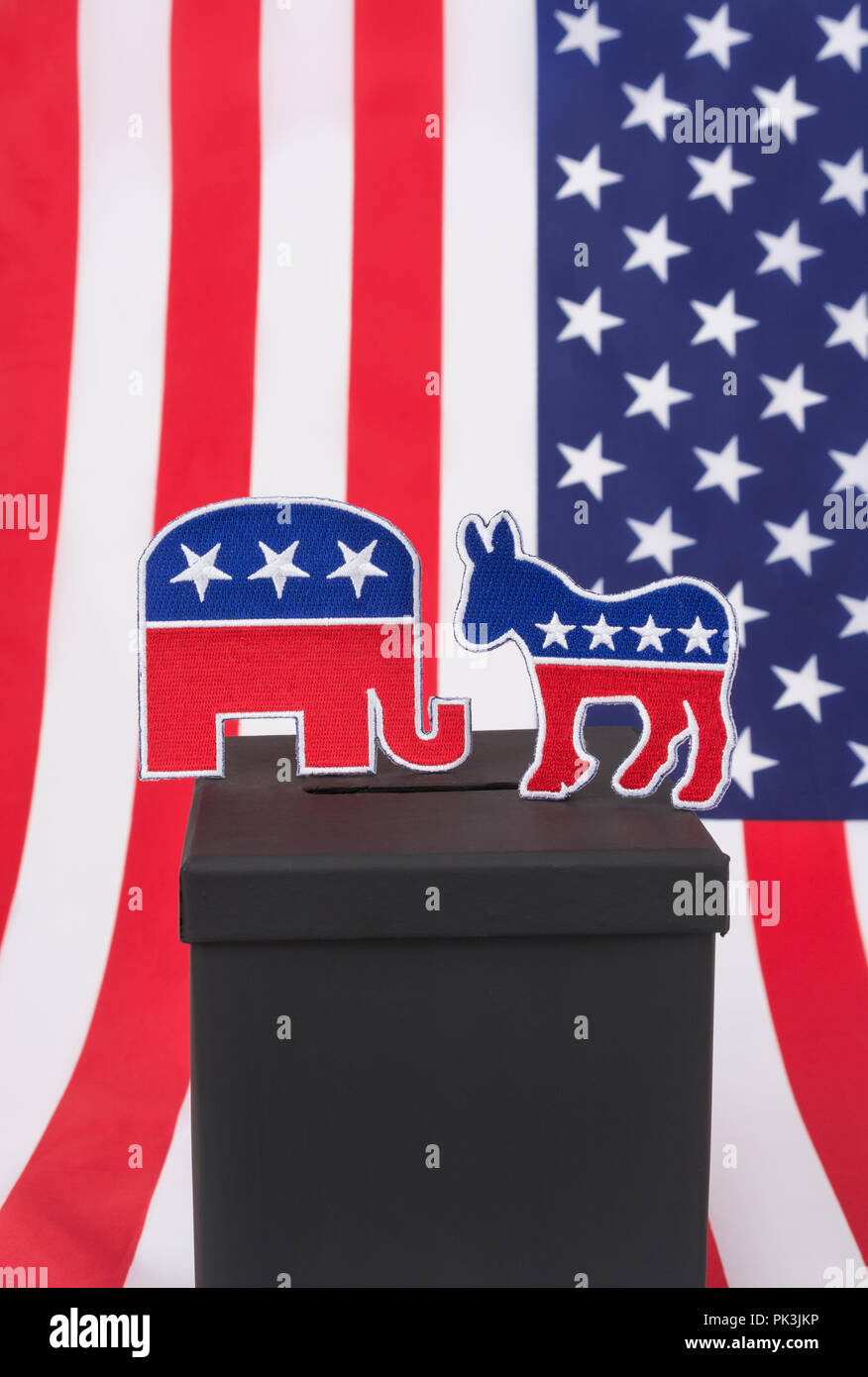 2018 US Midterm Election / Midterm elections America in November 2018. GOP / Republican  elephant and Democratic Donkey logos (patches) and ballot box - Stock Image