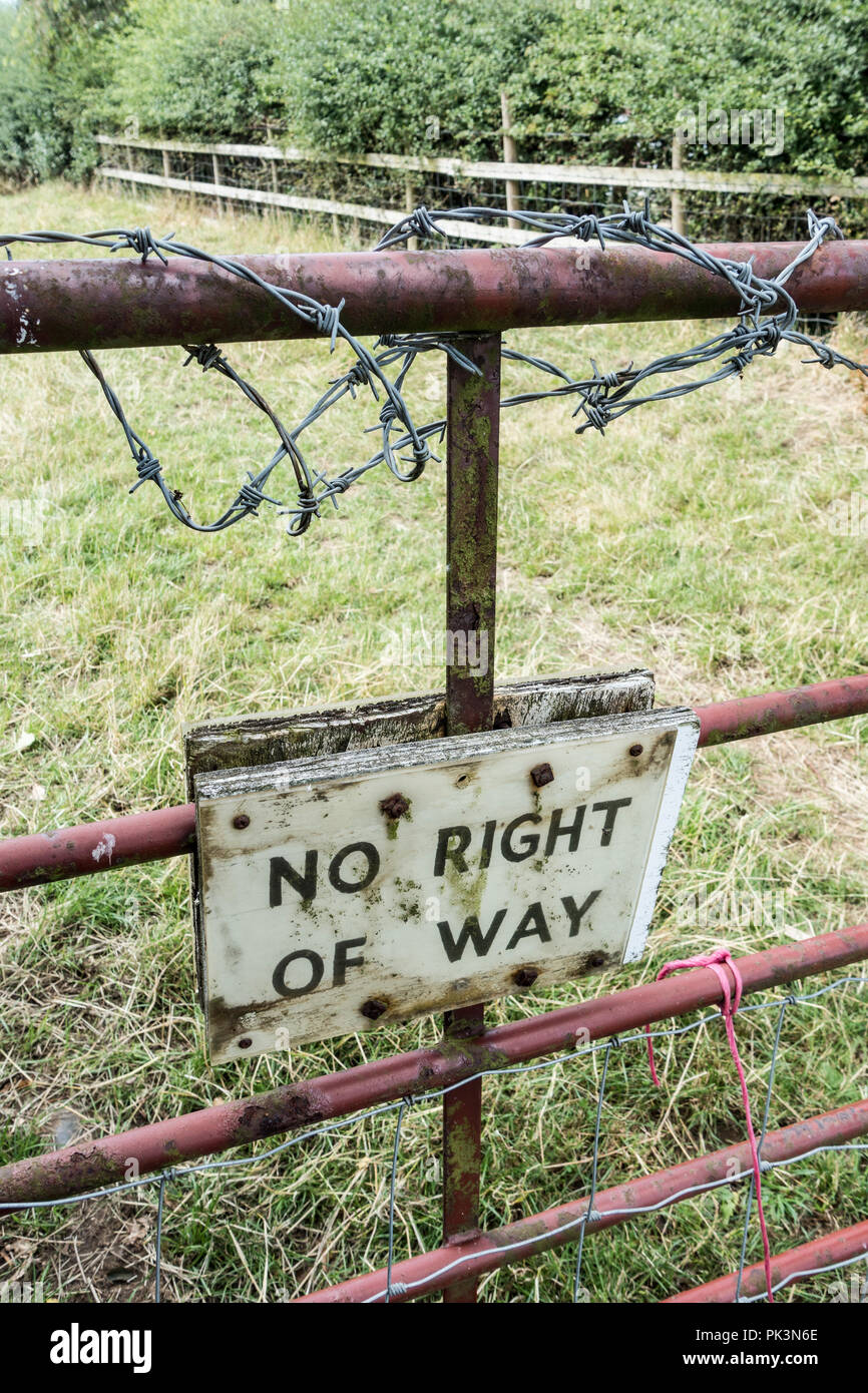 No right of way sign below barbed wire on farm gate in countryside. England. UK - Stock Image