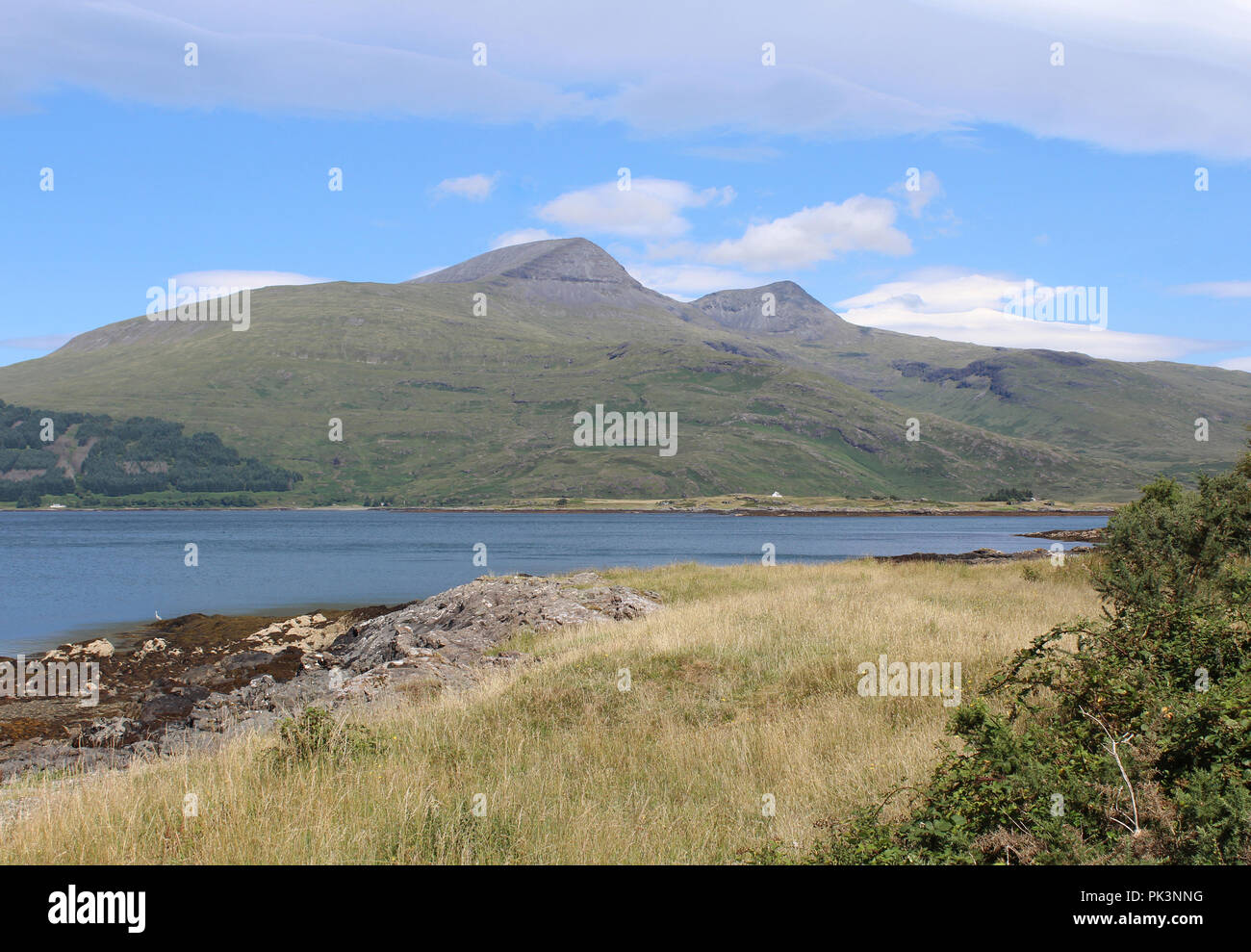 The mountain of Ben More, as viewed from Pennyghael looking across Loch Scridain on the Isle of Mull. - Stock Image