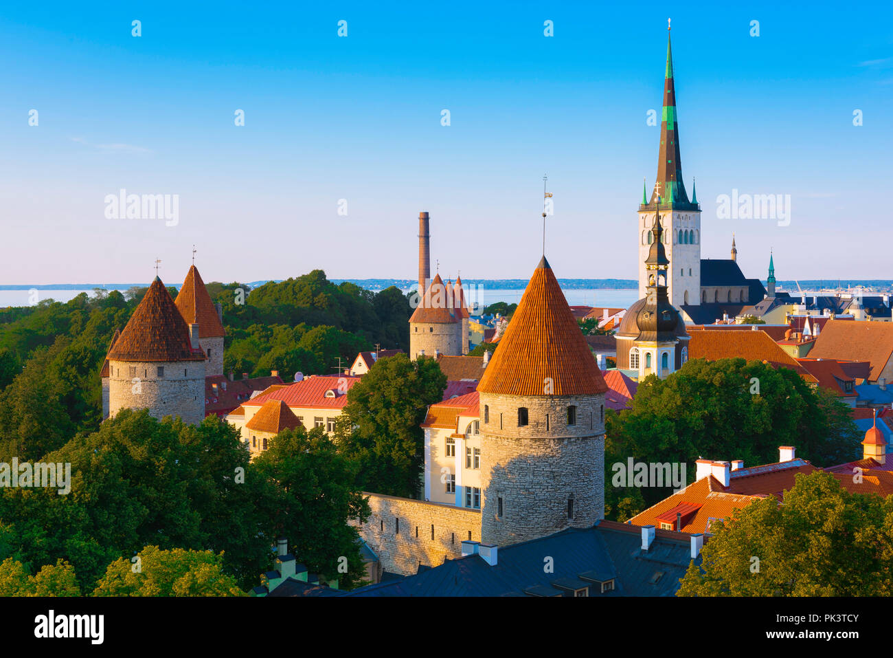 Tallinn skyline, view of the medieval Lower Town Wall and towers with St Olaf's Church in the distance, Tallinn, Estonia. Stock Photo