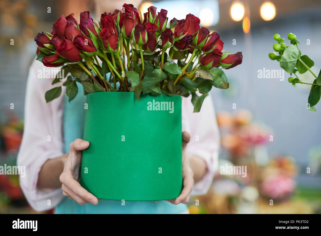 Florist Holding Roses Stock Photo