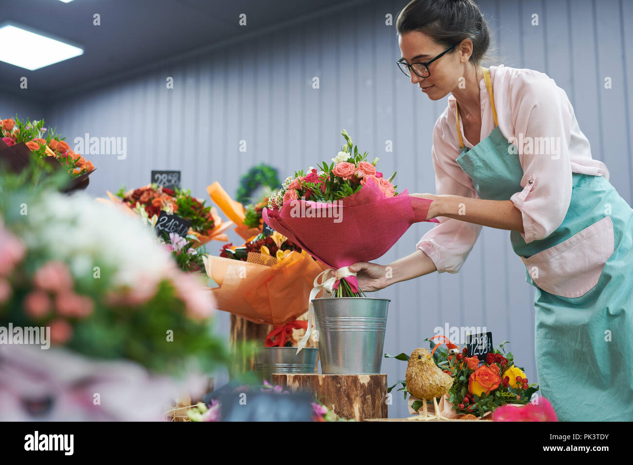 Florist Working in Shop - Stock Image