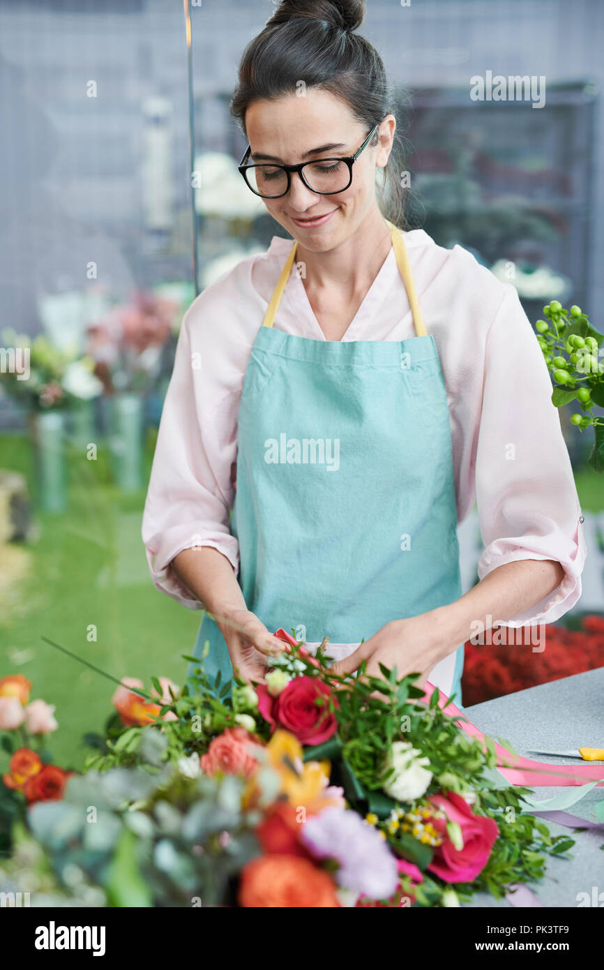 Florist Arranging Bouquets - Stock Image