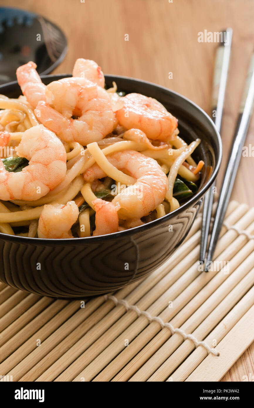King prawn Chow Mein or Lo Mein stir fried prawns with egg noodles vegetables and bean sprouts - Stock Image