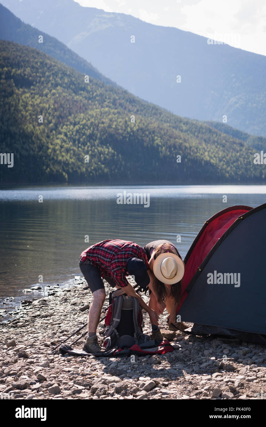 Couple setting up tent - Stock Image
