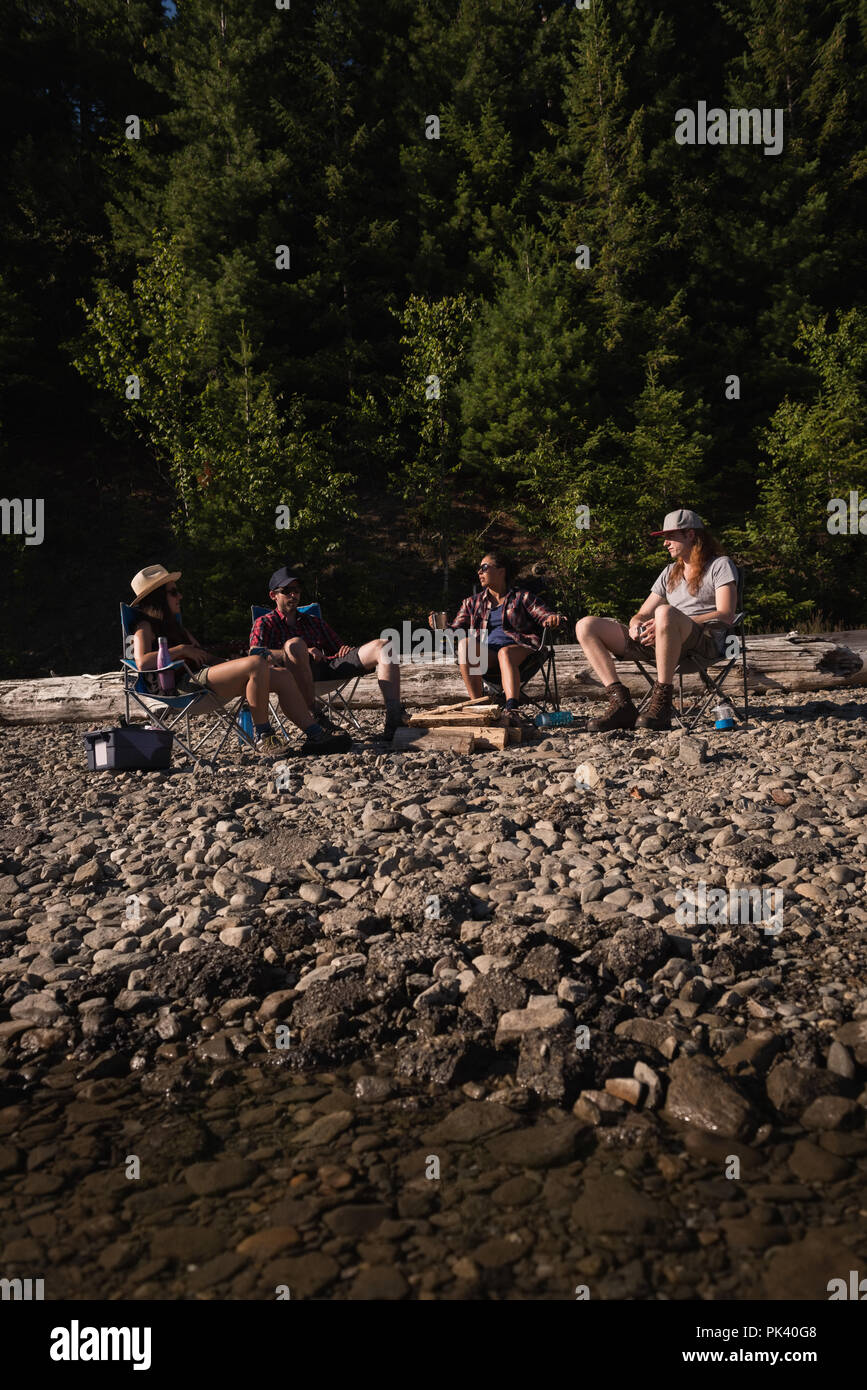 Group of hikers camping in countryside - Stock Image