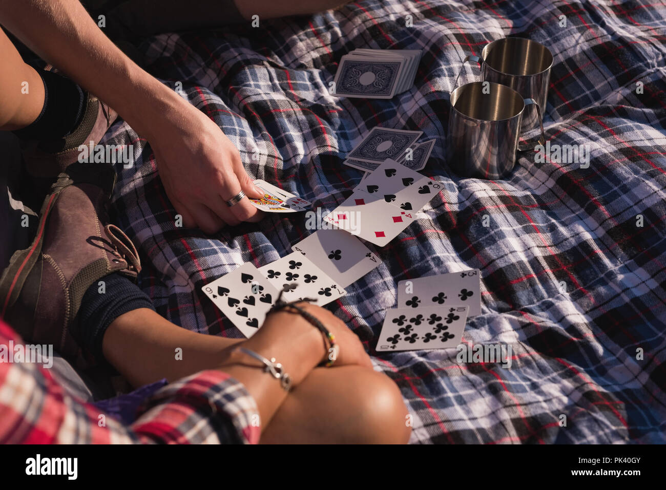 Couple playing with playing cards - Stock Image