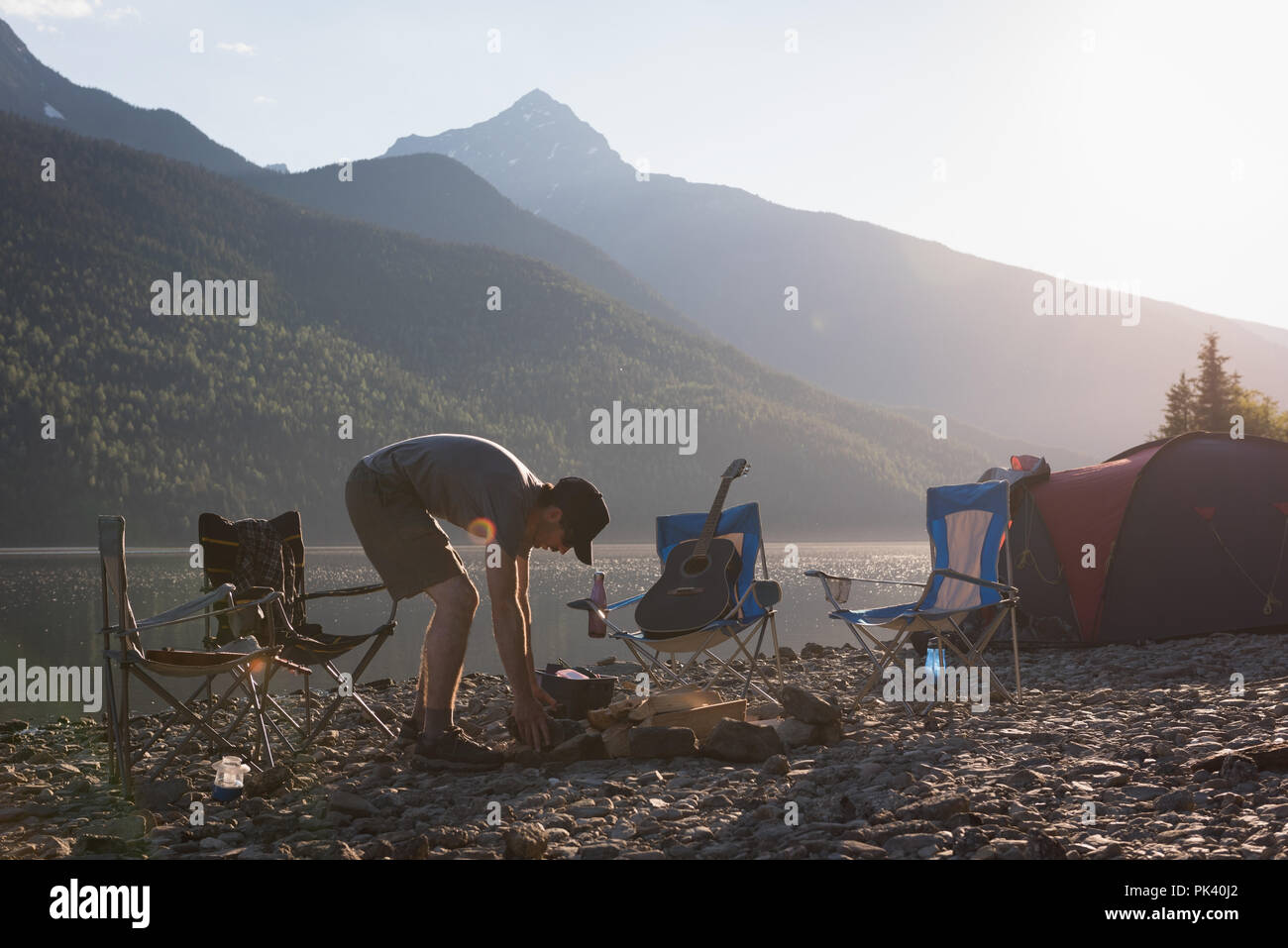 Man making preparation for campfire - Stock Image