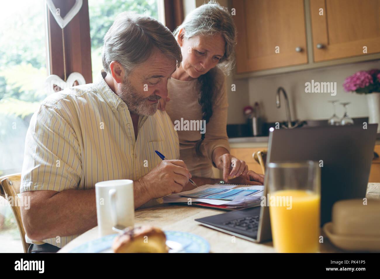 Senior couple checking invoice - Stock Image